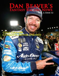 KANSAS CITY, KS - MAY 13:  Martin Truex Jr., driver of the #78 Auto-Owners Insurance Toyota, places the winner's decal on his car in Victory Lane during the Monster Energy NASCAR Cup Series Go Bowling 400 at Kansas Speedway on May 13, 2017 in Kansas City, Kansas.  (Photo by Jonathan Ferrey/Getty Images)